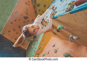 Happy little girl climbing indoor - Smiling sporty little...