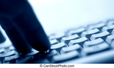 Fingers typing on keyboard - Close up of fingers typing on...