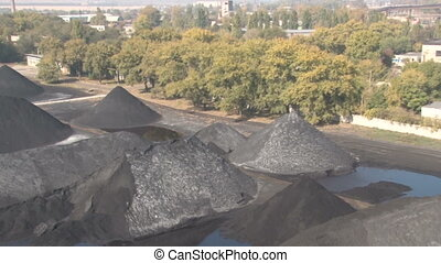 Mined coal, lying on the ground - Coke and Chemicals plant...