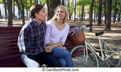 Couple with retro bike in the park - Yong couple with retro...