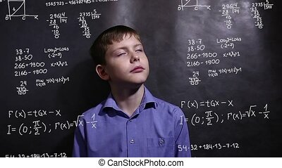 Student teenager boy thinks science formula math problem...