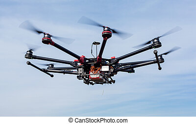 Octocopter, copter, quadrocopter - Copter against a blue sky...