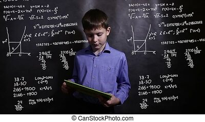 Student teenager boy running on the tablet science formula...