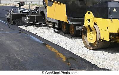 Construction - Industrial pavement truck laying fresh...