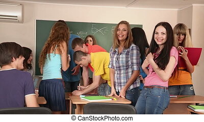 Group of students in classroom - Group of students in the...