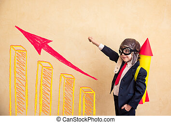 Start up - Portrait of young businessman with paper rocket....