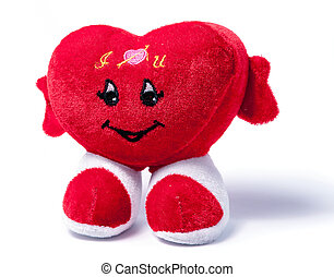 Symbolic plush red heart isolated over the white background