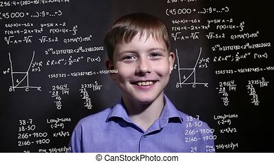 Student teen boy talking science formula math problem math...