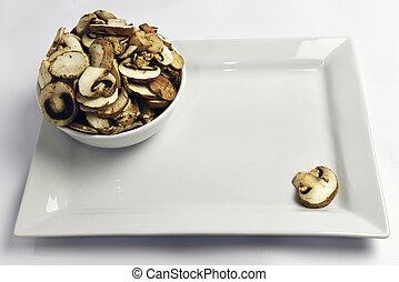 Crimini Mushrooms Agaricus bisporus - Sliced mushrooms in a...