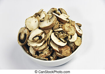 Crimini Mushrooms Agaricus bisporus - Sliced mushrooms in a...