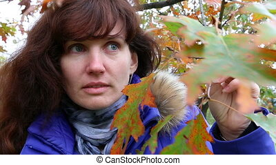 Surprised woman in autumn outdoor.
