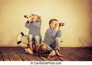 Travel - Children playing with vintage nautical things. Kids...