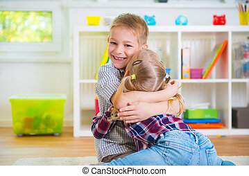 Cute brother and sister having fun - Cute little brother and...