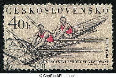 postmark - CZECHOSLOVAKIA - CIRCA 1961: Rowers in a rowing...