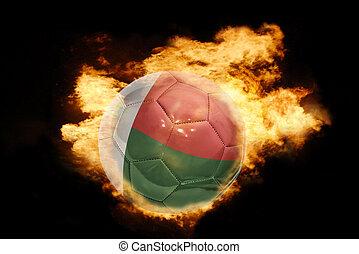 football ball with the flag of madagascar on fire - football...