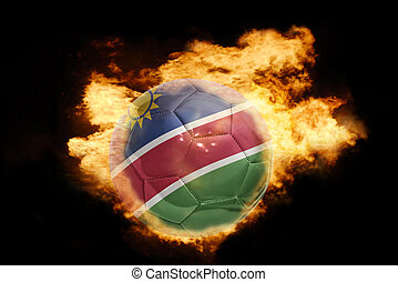 football ball with the flag of namibia on fire - football...