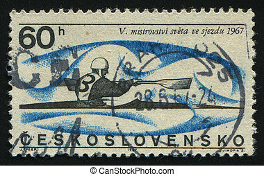 postmark - CZECHOSLOVAKIA - CIRCA 1967: Athletic man. Canoe...