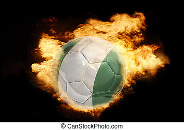 football ball with the flag of nigeria on fire - football...