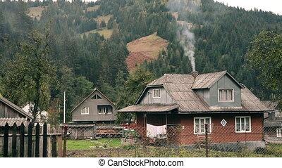 Smoking chimney at rustic home