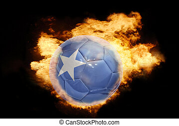 football ball with the flag of somalia on fire - football...