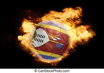 football ball with the flag of swaziland on fire - football...