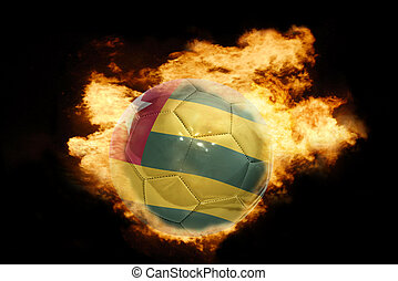 football ball with the flag of togo on fire - football ball...