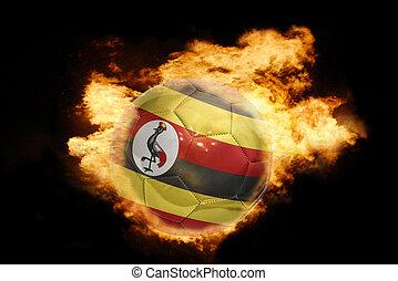 football ball with the flag of uganda on fire - football...