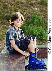 boy wearing roller skates