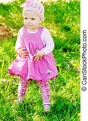 baby girl outdoors weaing dress and shoes