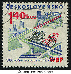 postmark - CZECHOSLOVAKIA - CIRCA 1977: Bicyclists on...