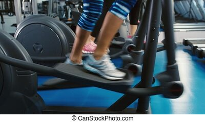 Legs work on elliptical trainer