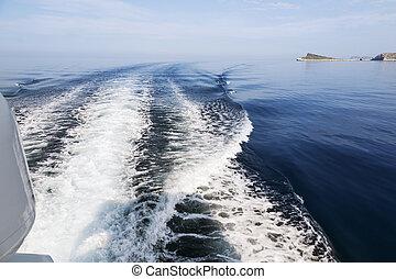 Waves behind boat underway, Croatia