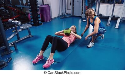 Woman doing exercises for the press - Attractive woman doing...