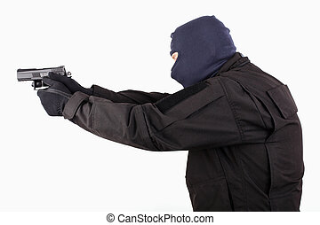 man in mask with a gun on white background