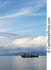 Fishing Trawler - Single small fishing trawler leaving the...