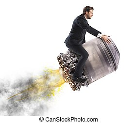 Businessman flying high - Determined businessman over a...