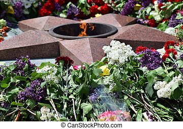 The laid flowers to an eternal flame in honor of a Victory Day on May 9