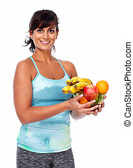 Healthy young woman with fruits.