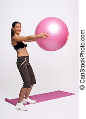 Gym ball - A photo of a girl doing exercises with gym ball.