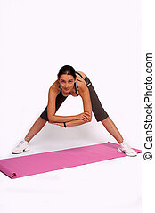Bending down - A photo of a woman doing bending stretches.