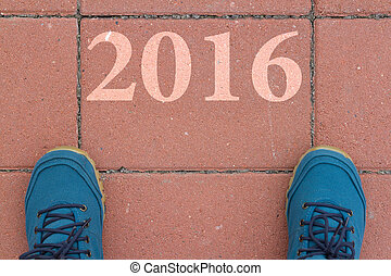 Start to new year 2016 - top view of  man walking on the road