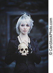 unusual girl holding skull, loss of loved one, crying face,...