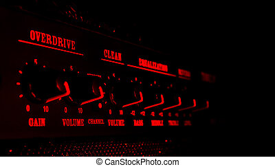guitar amplifier control panel in red light, black...