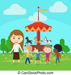 Teacher leads children in kindergarten against the backdrop...