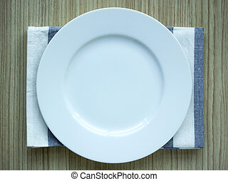 empty white plate with tablecloth