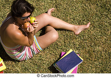 Studing at the school grass - a student relaxing at the...