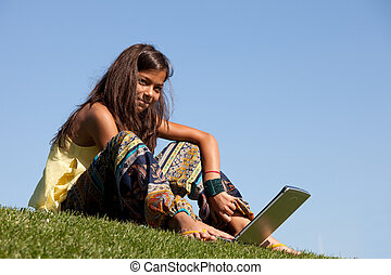 Modern student little girl - little girl studing with her...