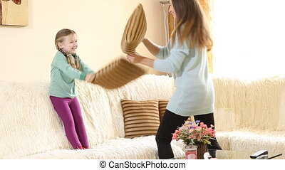mother with her baby pillow fight - Mom with a child...