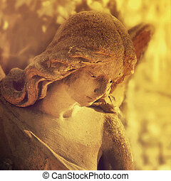 golden angel in the sunlight (antique statue styled vintage)...