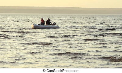 Two mans fishing together in a boat. - Two mans fishing...